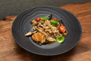 Nick Lee's Butter Poached Abalone, served with roasted mushroom risotto